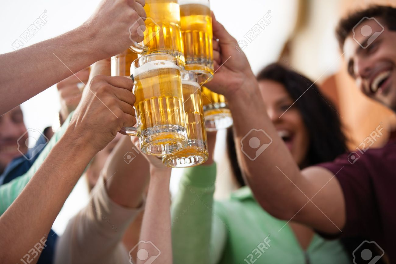 Group of Attractive young People toasting with a delicious Pale Ale  Beer Stock Photo - 19969143