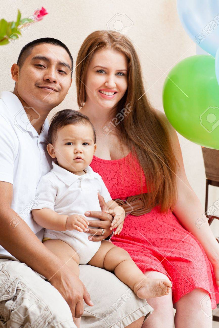 Happy young family on babies first birthday stock photo 20760168
