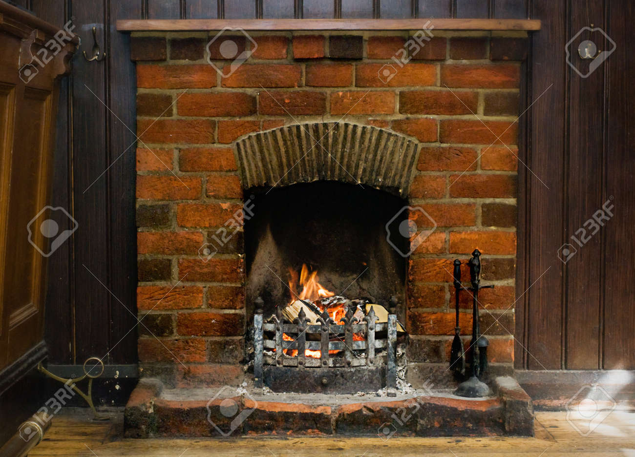 old brick fireplace burning logs stock photo picture and royalty