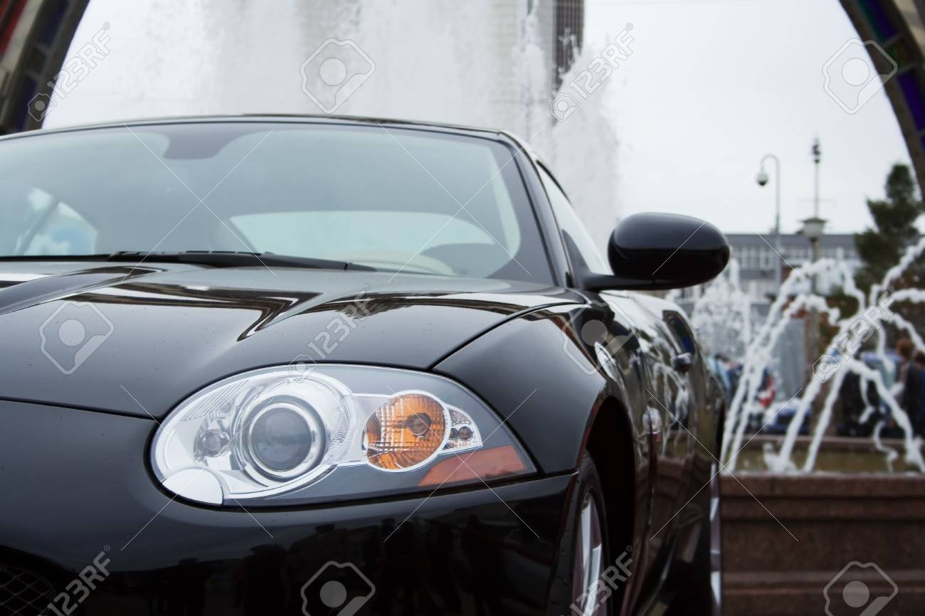 The modern sports car at a fountain. Stock Photo - 2374768
