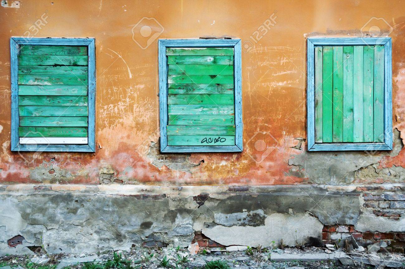 Three boarded up windows. Stock Photo - 5927224