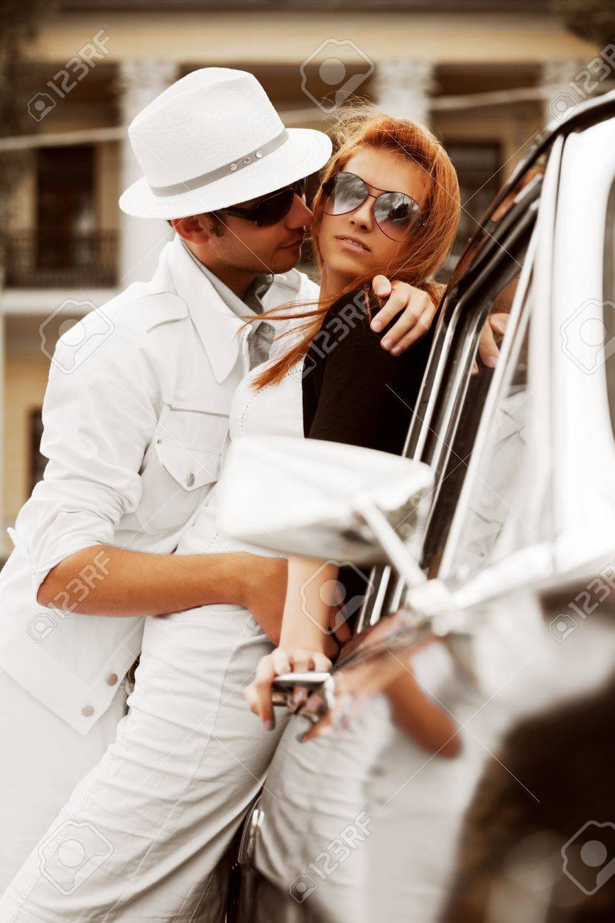 Young couple with a retro car. Stock Photo - 8393077