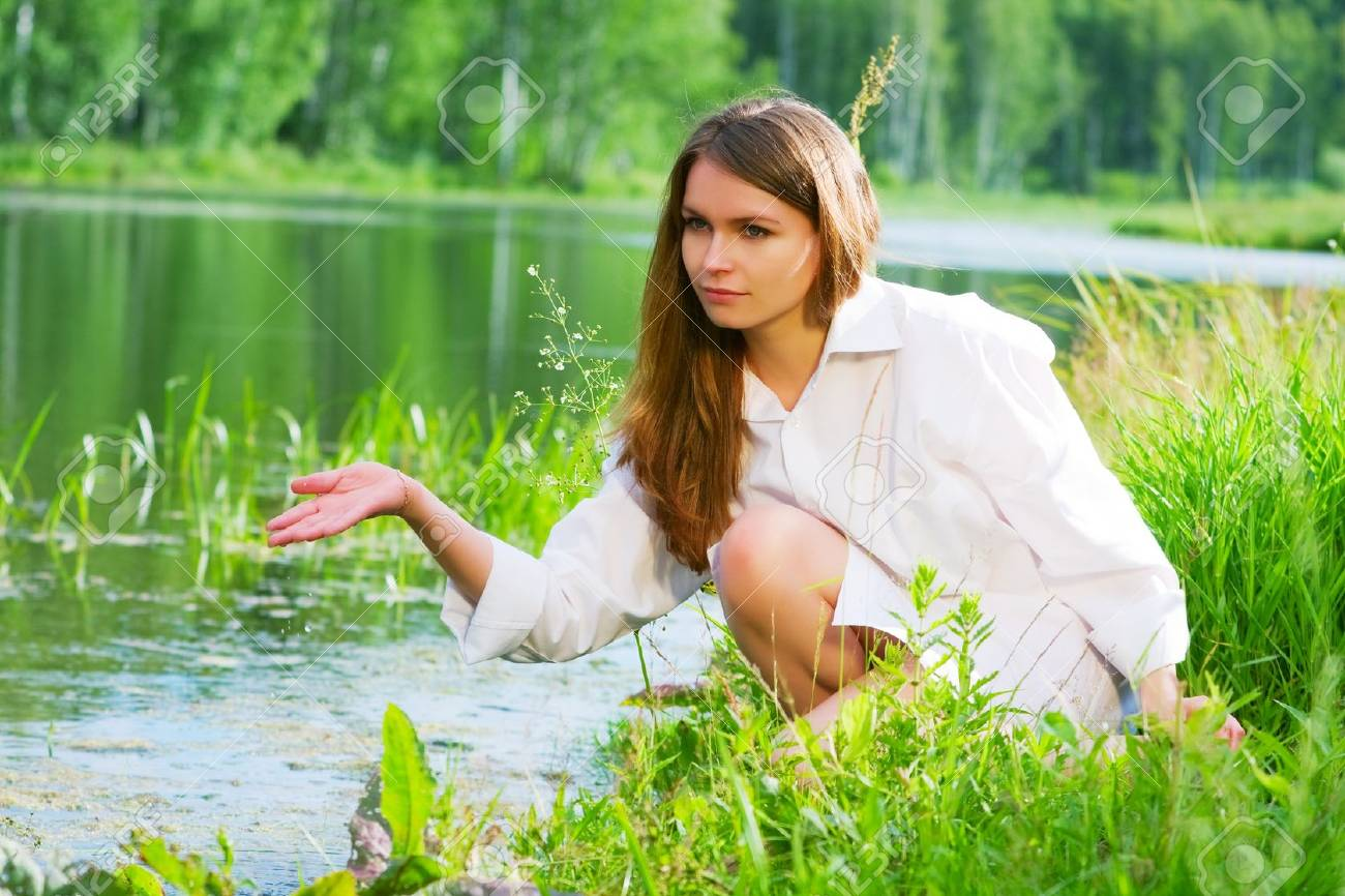 Young woman relaxing by the lake Stock Photo - 9210434