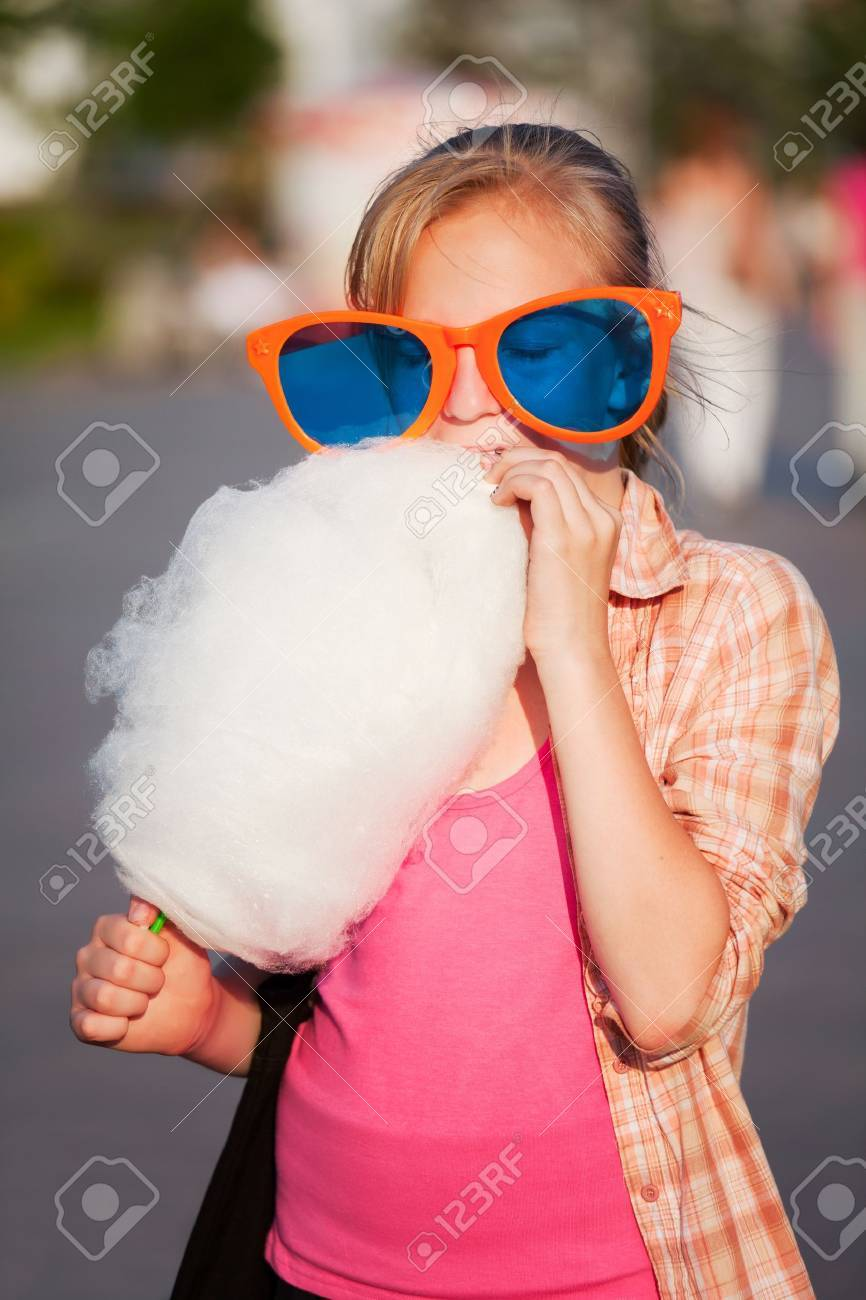 Girl eating cotton candy Stock Photo - 10181282