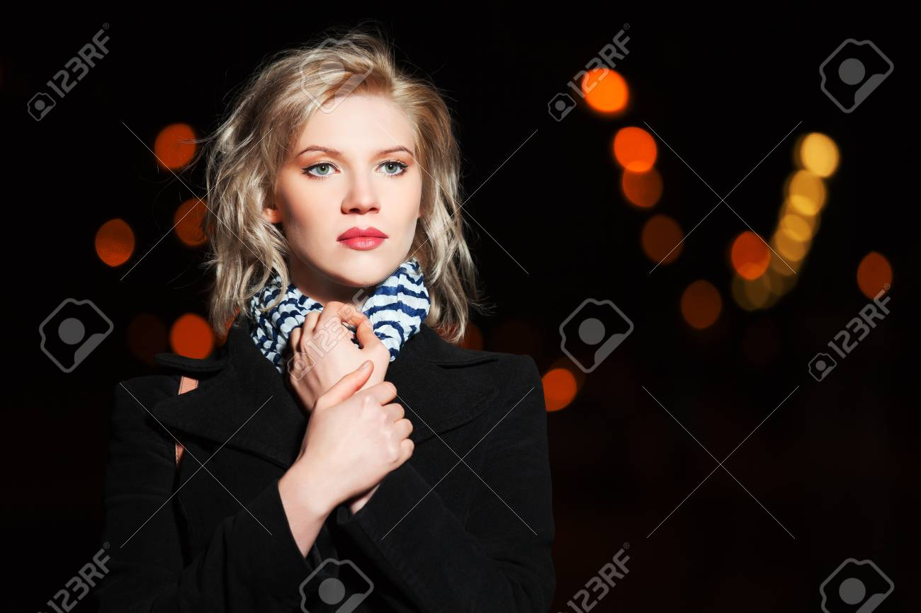 Young woman on the night city street Stock Photo - 16191101