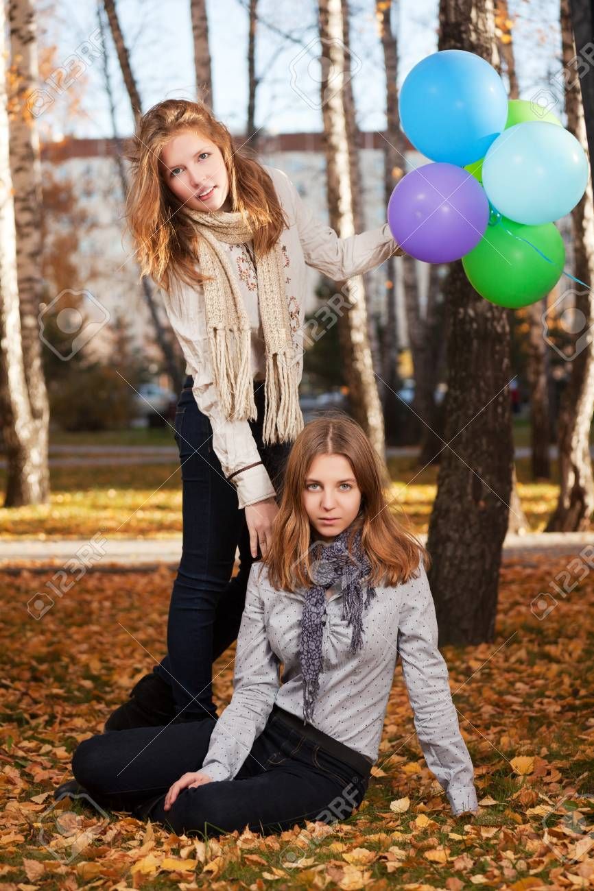 Young girls in an autumn park Stock Photo - 16411121
