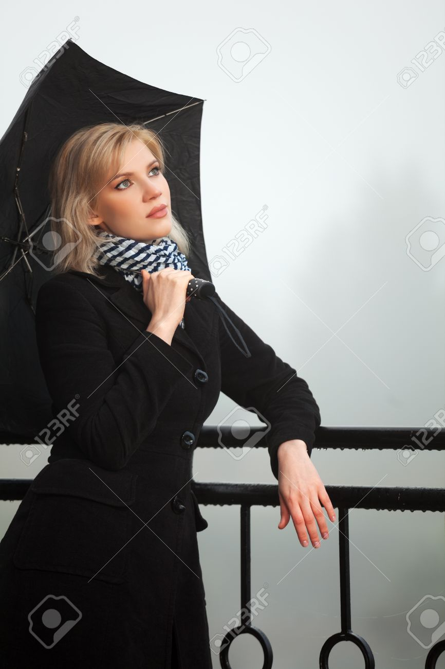 Young woman against a morning foggy landscape Stock Photo - 16443595