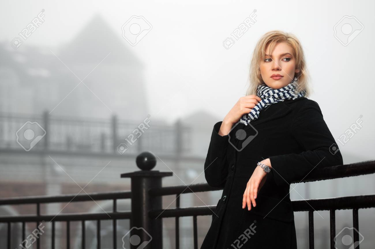 Young woman in autumn foggy morning Stock Photo - 16494732