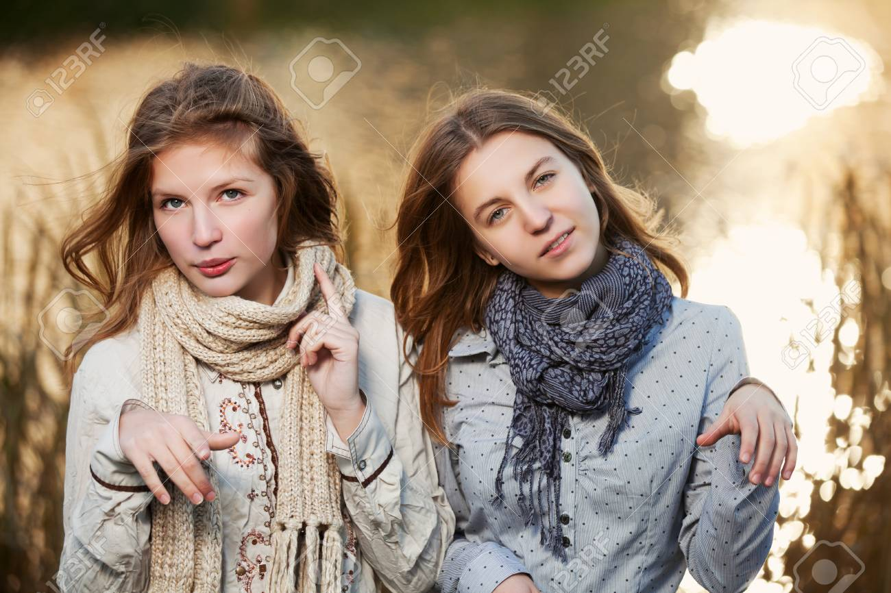 Young girls against an autumn nature Stock Photo - 17157361