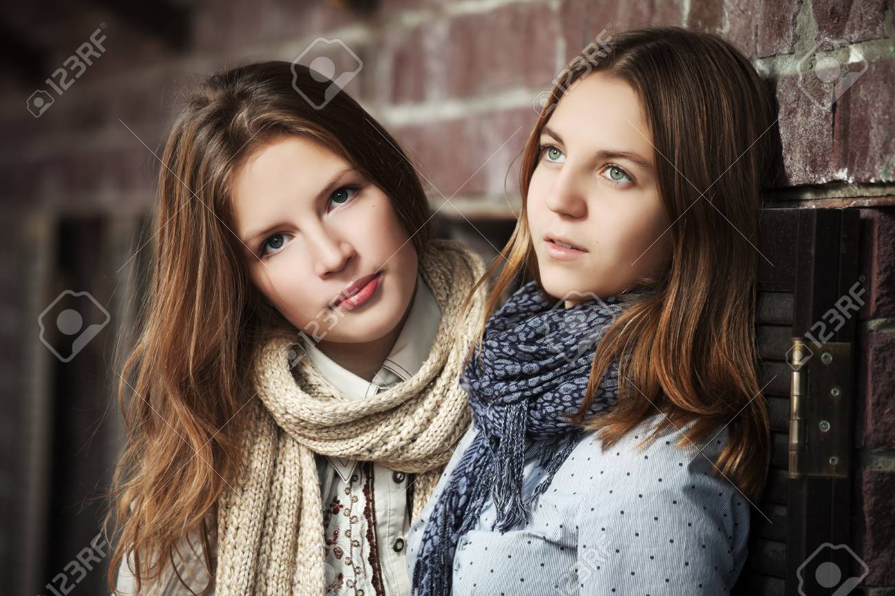 Young girls against a brick wall Stock Photo - 17206416