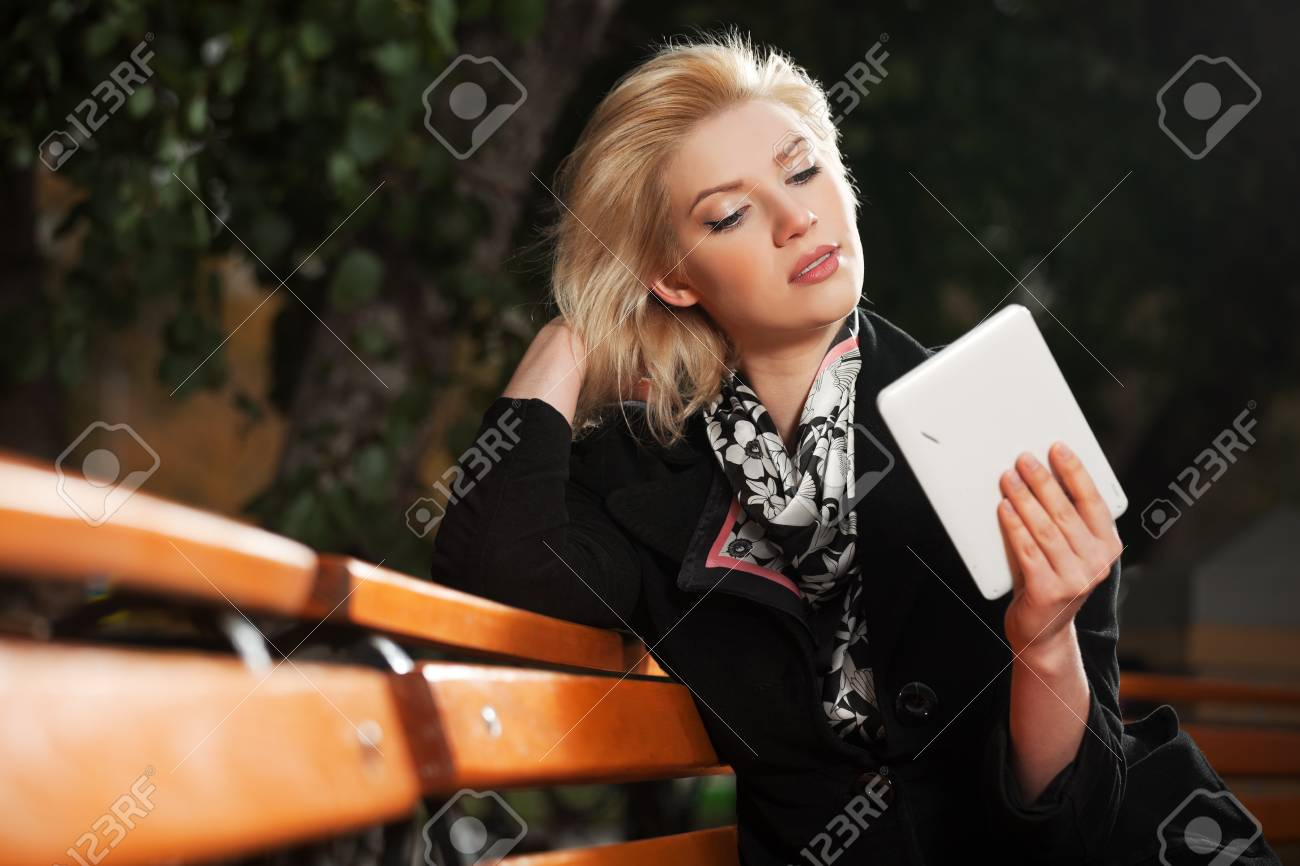Blond woman holding a digital tablet computer Stock Photo - 17480380