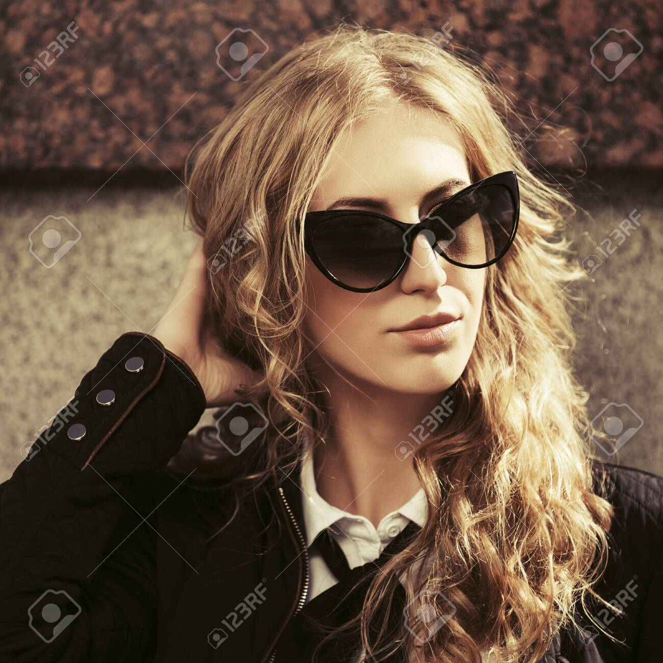 Young fashion blonde business woman Stylish female model in black jacket and sunglasses - 147525522
