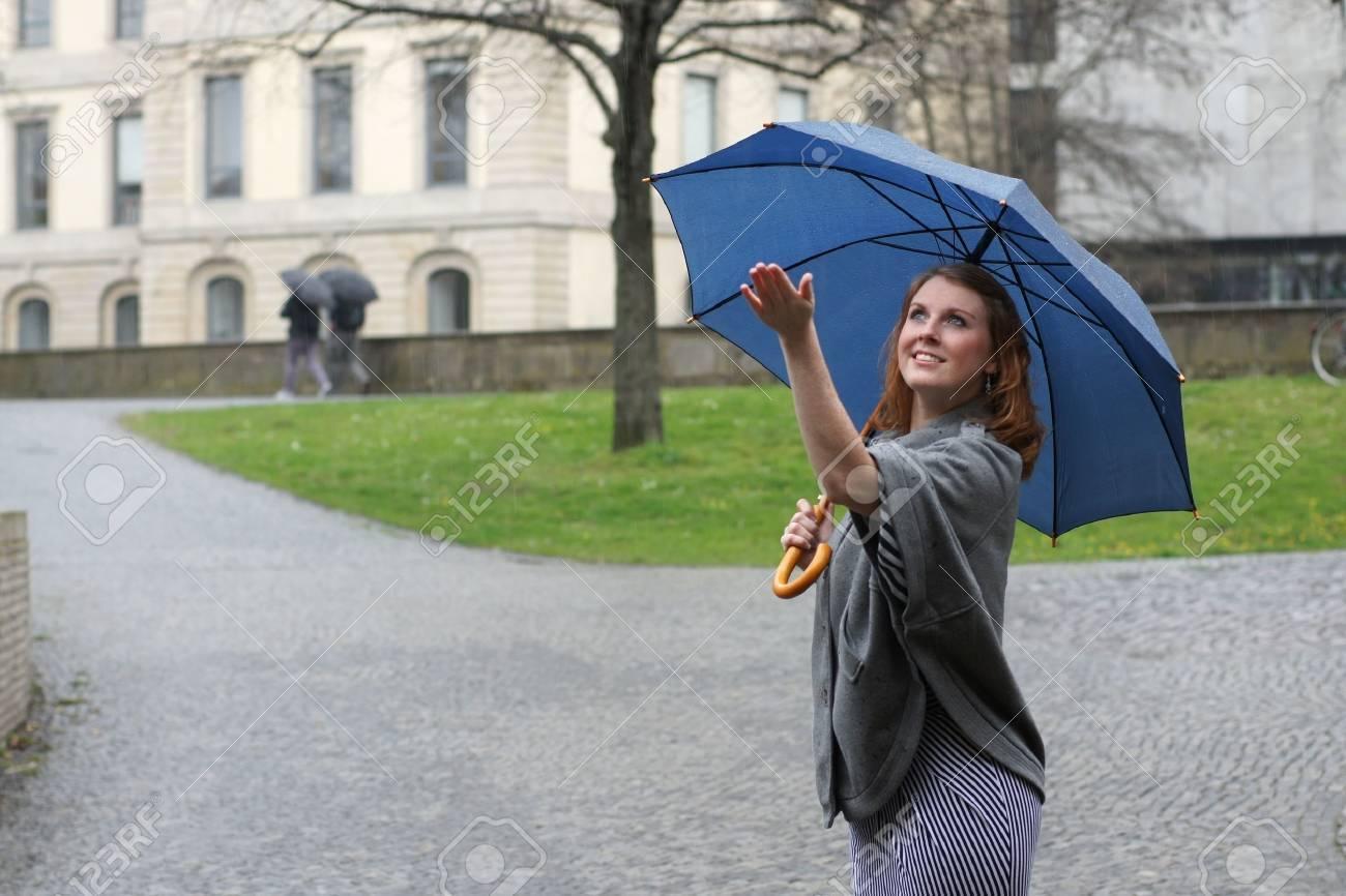 young woman enjoying the rain Stock Photo - 9241192