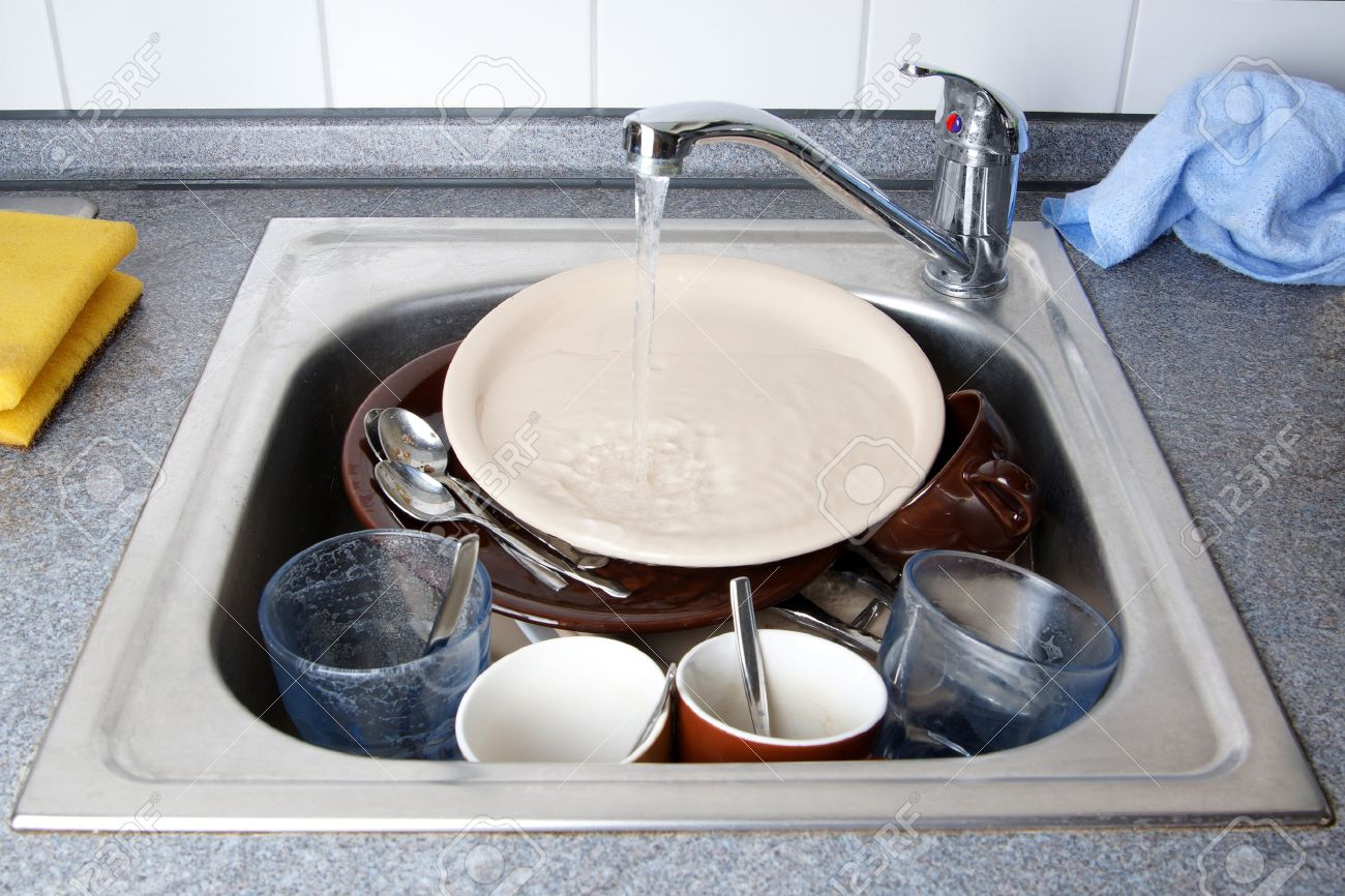 Dirty Kitchen Sink Pile of dirty dishes in kitchen sink with running water stock photo pile of dirty dishes in kitchen sink with running water stock photo 30852408 workwithnaturefo