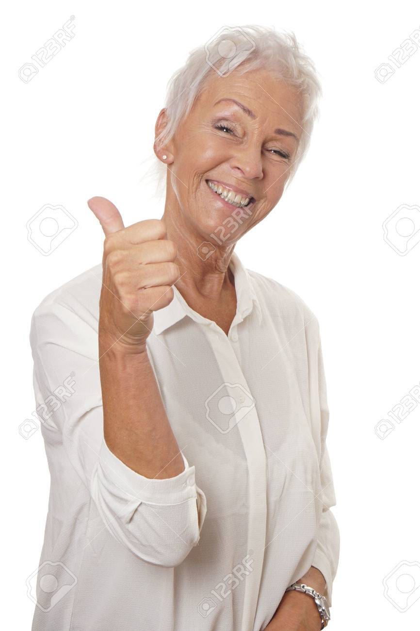 happy smiling mature woman in her sixties with trendy white short