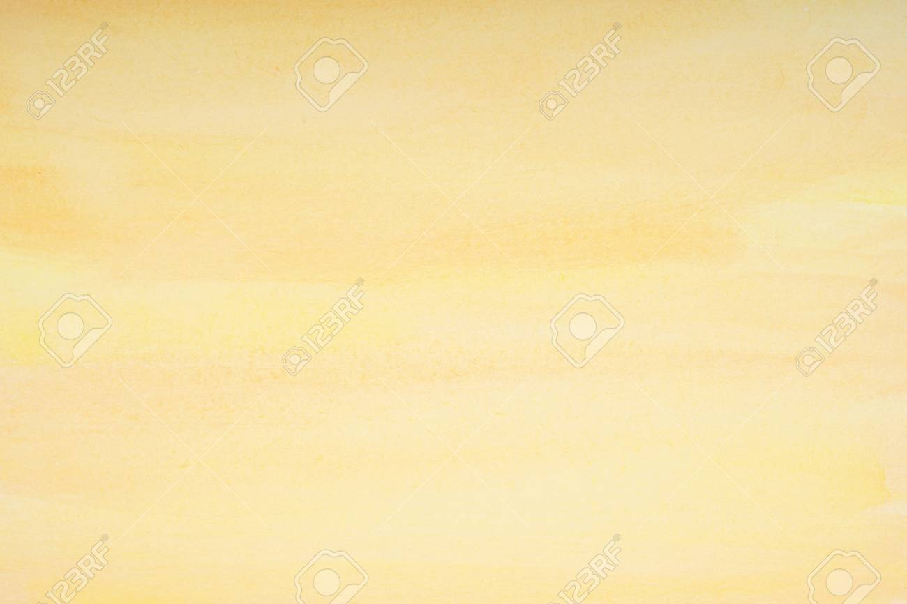 yellow watercolor background with visible brushstrokes and paper texture - 66602809