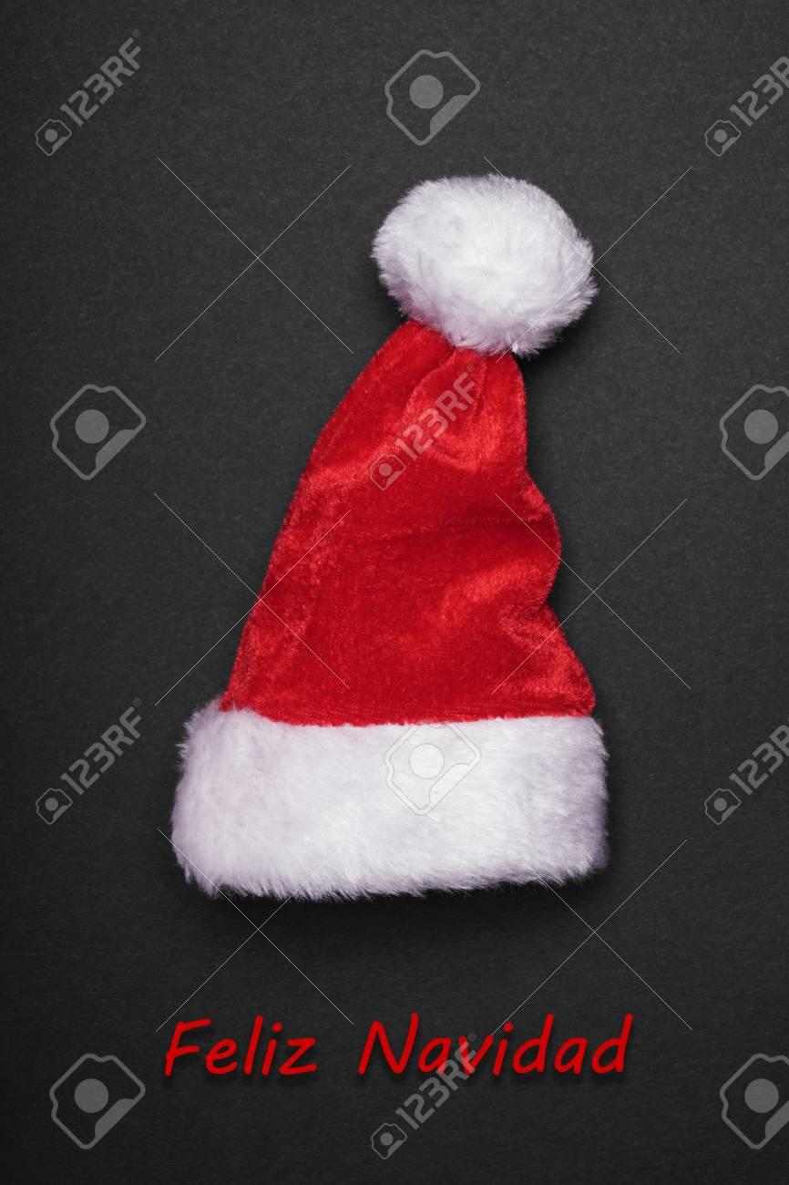 Feliz navidad spanish christmas greeting card with santa hat stock feliz navidad spanish christmas greeting card with santa hat stock photo 88077920 m4hsunfo