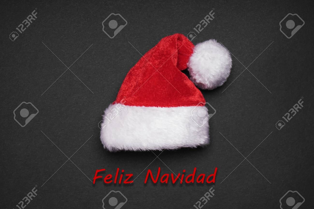 Feliz navidad spanish christmas greeting card with santa hat stock feliz navidad spanish christmas greeting card with santa hat stock photo 88163876 m4hsunfo