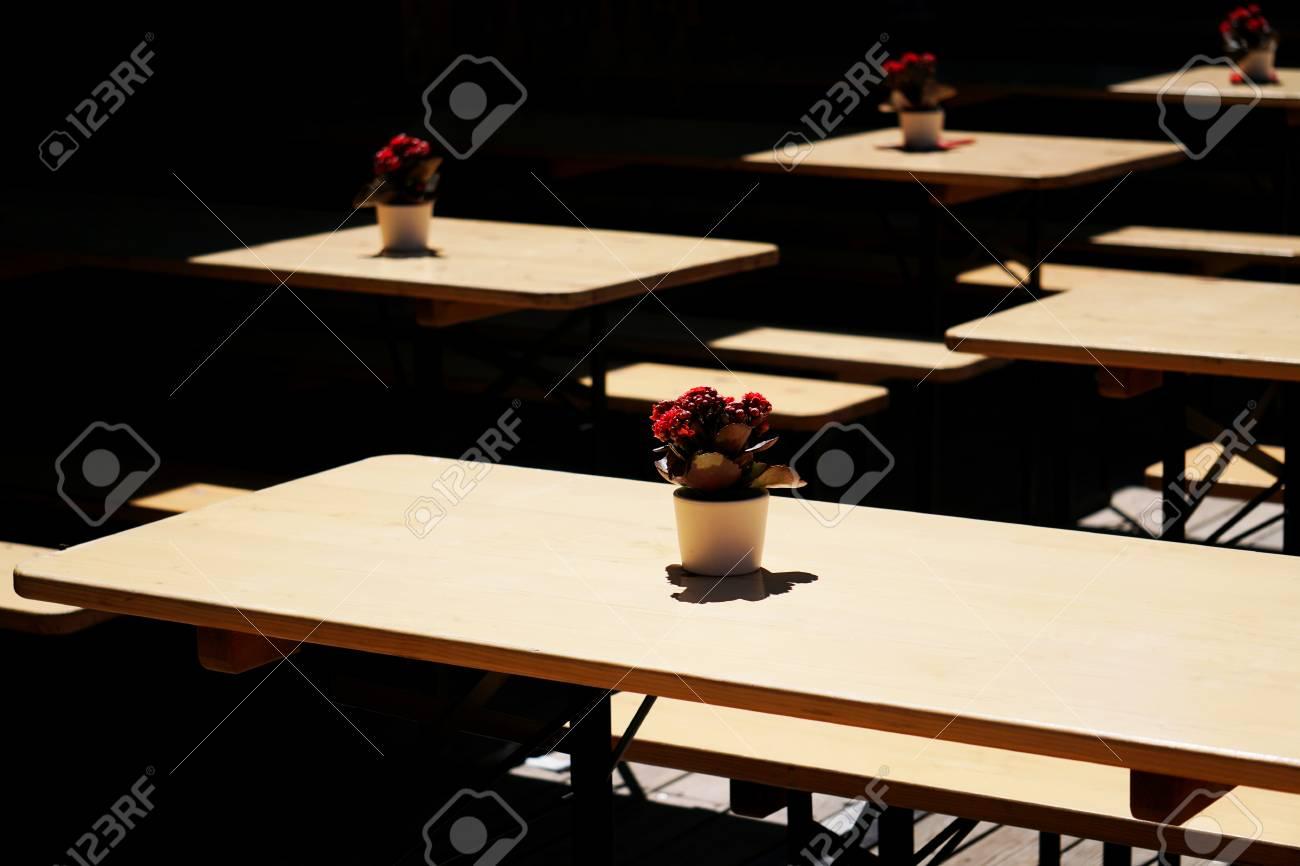 Fantastic Empty German Biergarten Or Beer Garden Wooden Outdoor Tables Evergreenethics Interior Chair Design Evergreenethicsorg