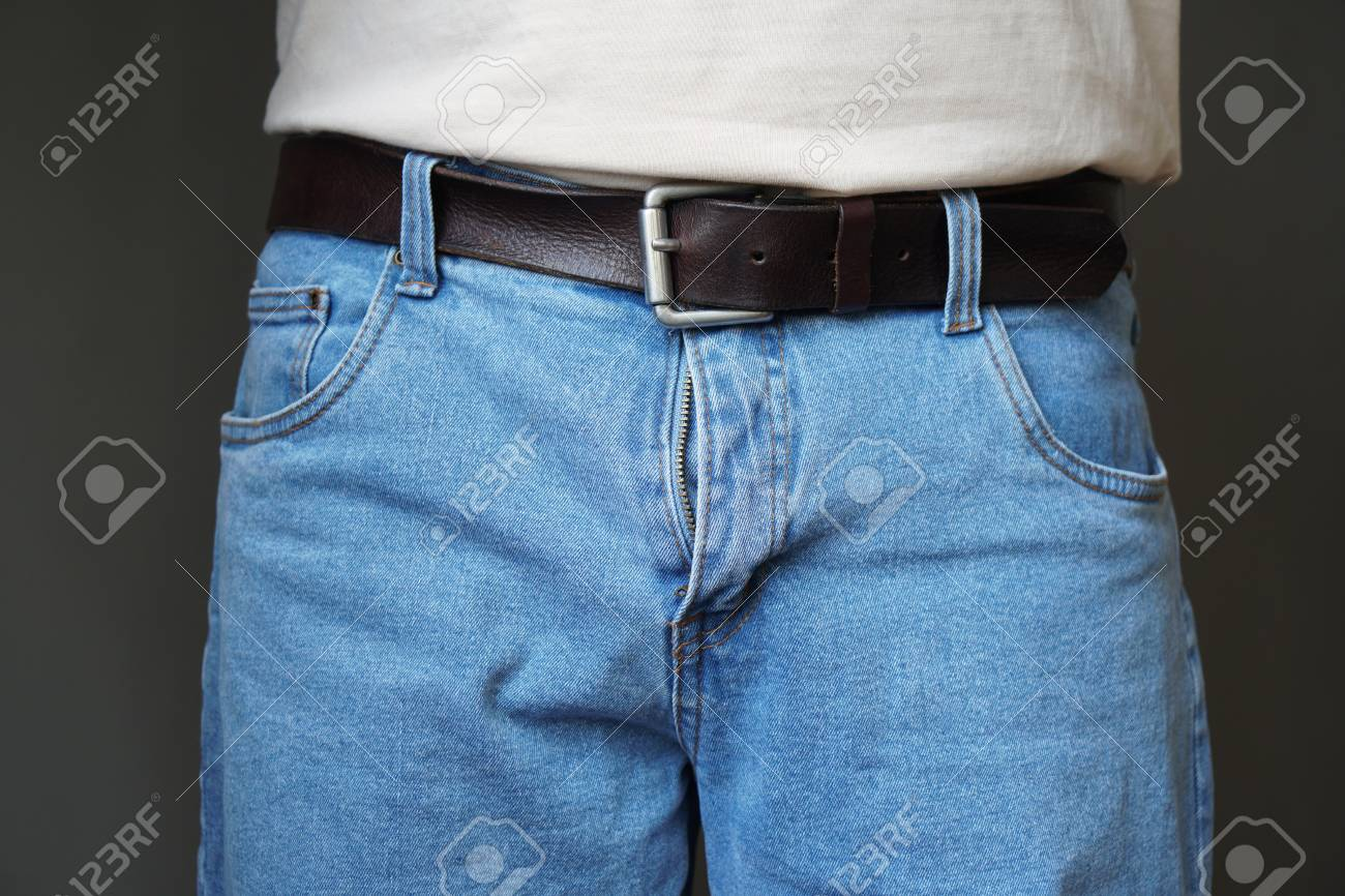 midsection of unrecognizable man dressed in jeans with open fly or flies or zipper - 108439074
