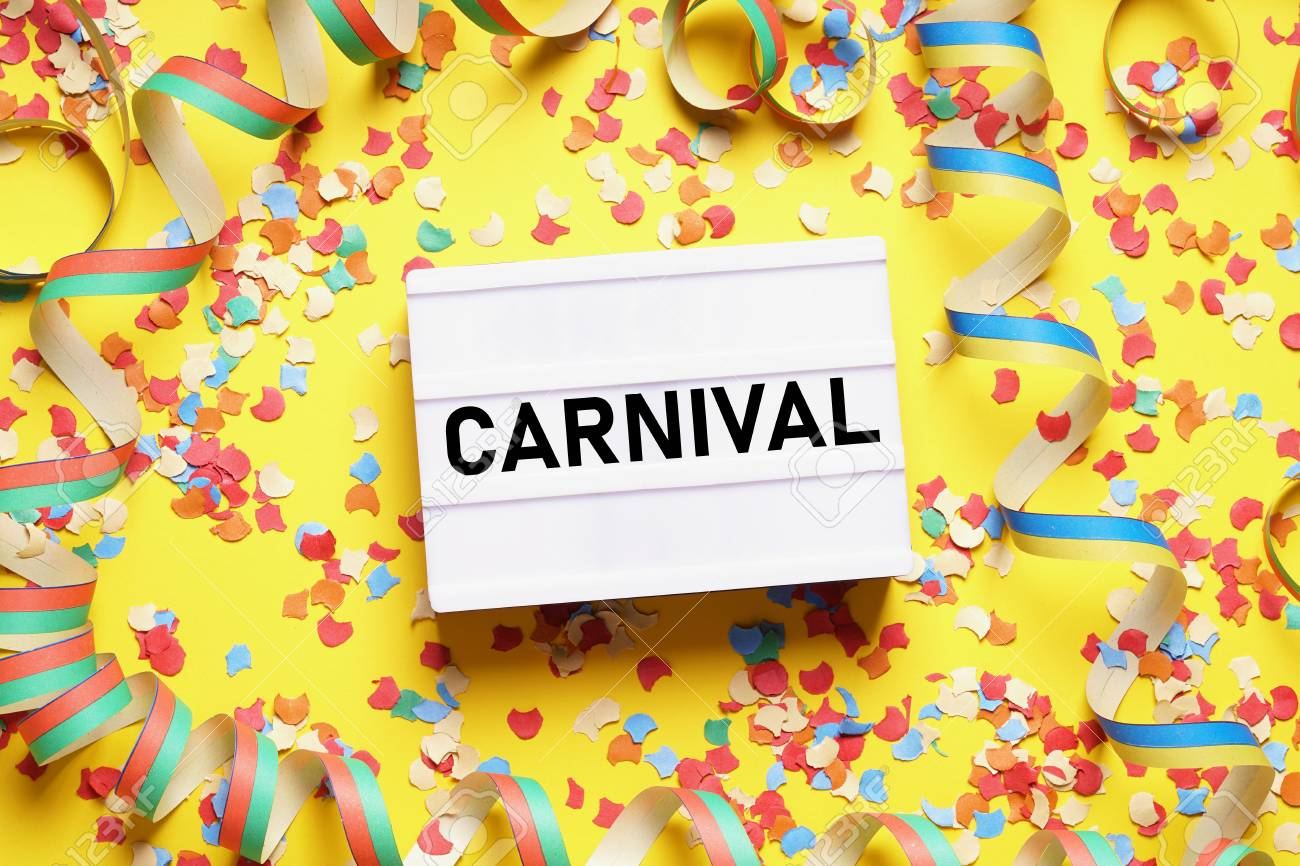 carnival flat lay with text on light box sign confetti and streamers - 122167421