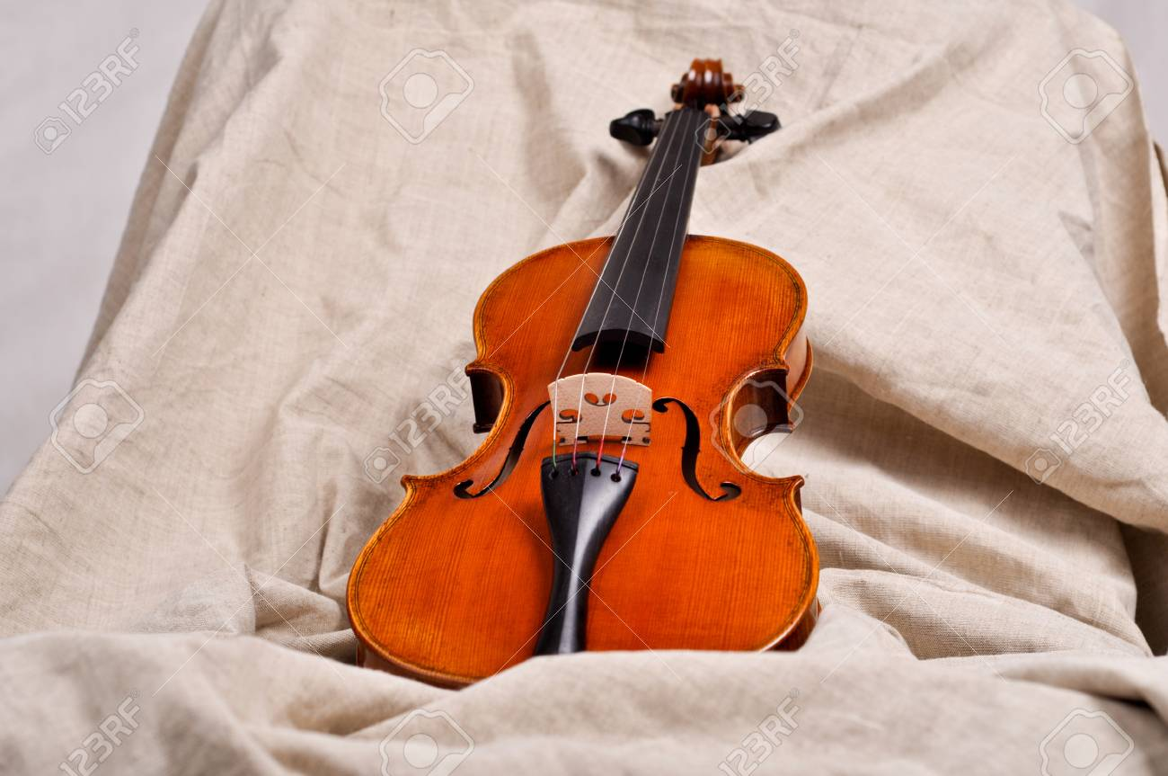 Violin on beige background Stock Photo - 18880196