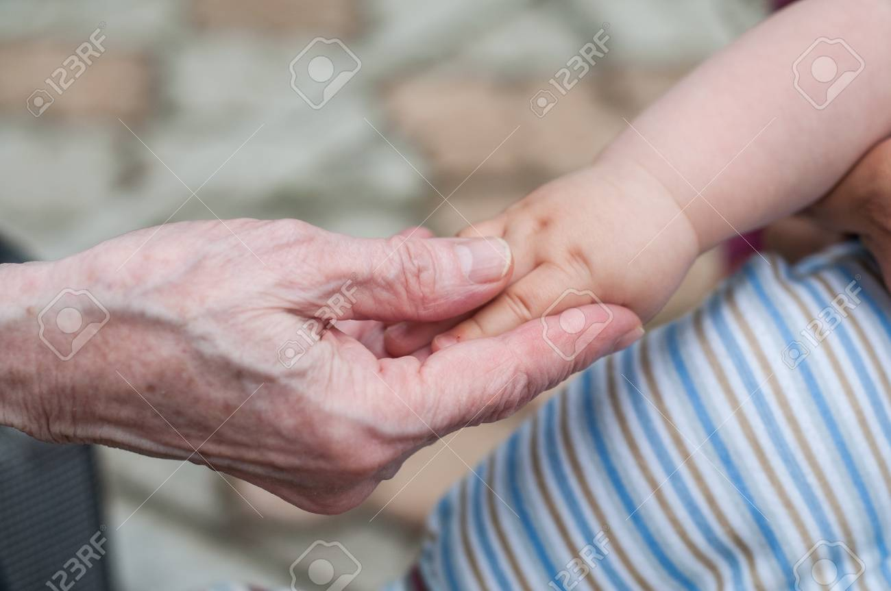 hands of baby grandson and old grandmother, concept of family relationship and passage of time Stock Photo - 19971535