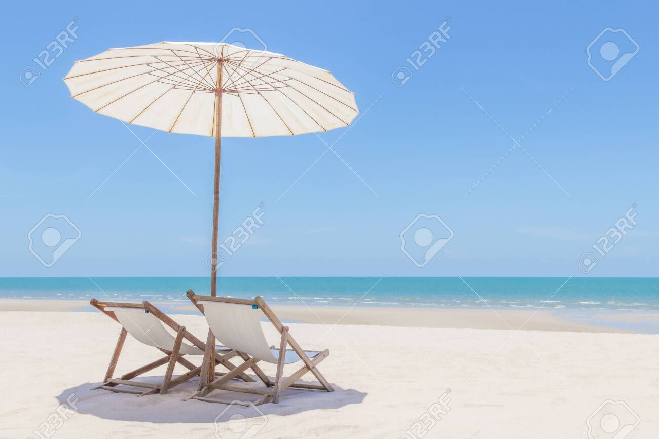 Idyllic tropical beach with white sand, turquoise ocean water and blue sky in huahin thailand - 141064931
