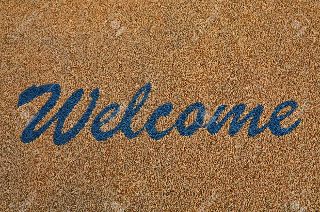 Blue Welcome Sign On A Carpet Stock Photo - 11321311