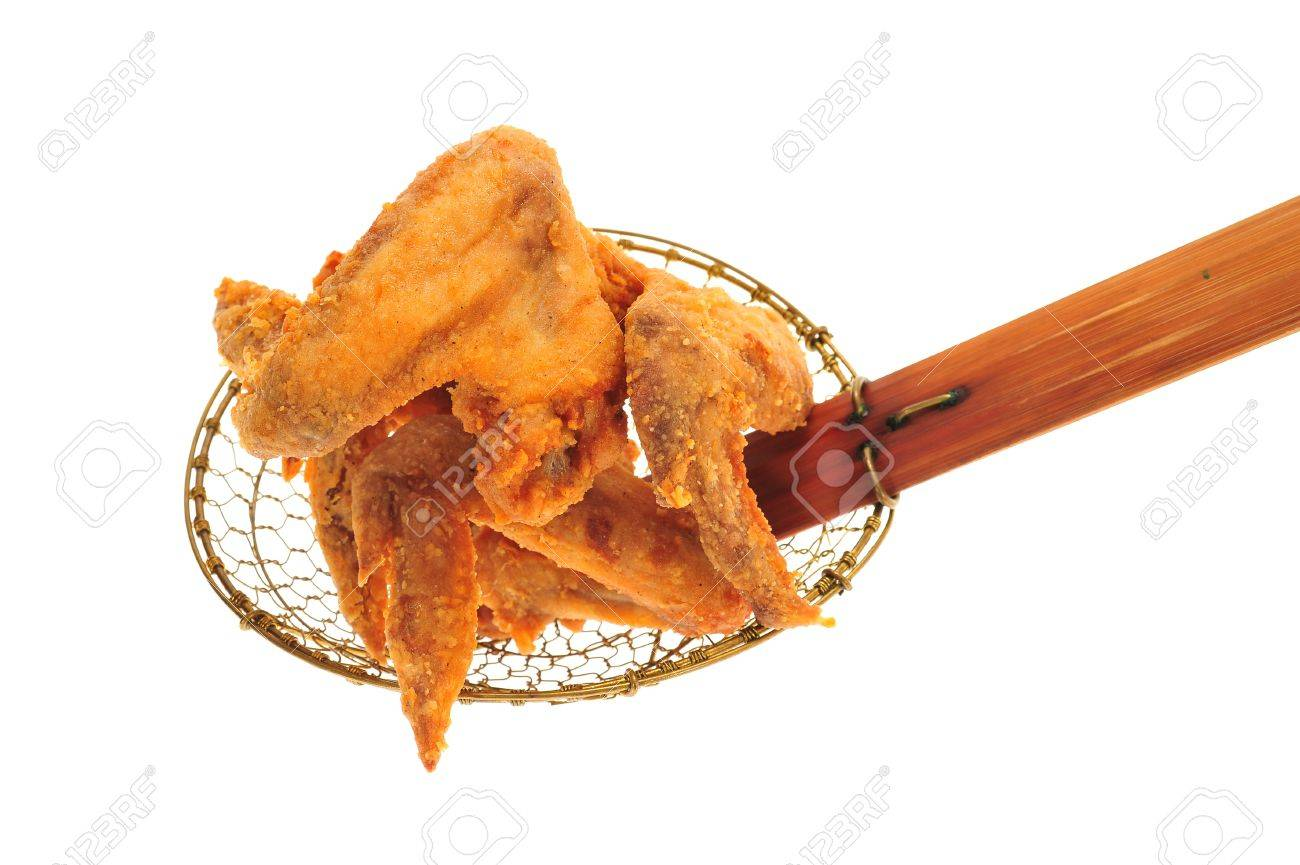 Fried Chicken Wings On A Kitchen Strainer Stock Photo - 13709578