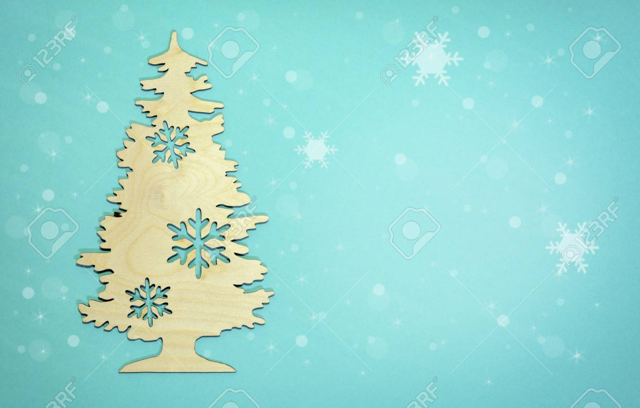 new year background christmas tree with falling snow flakes on light blue stock photo 91231496