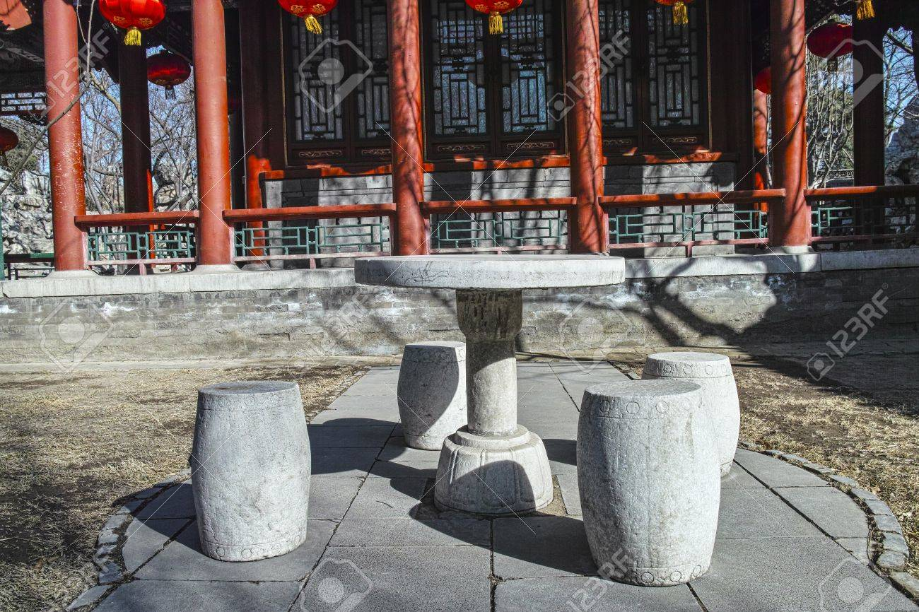 A Stone Table And Benches In Chinese Garden Stock Photo   21907126