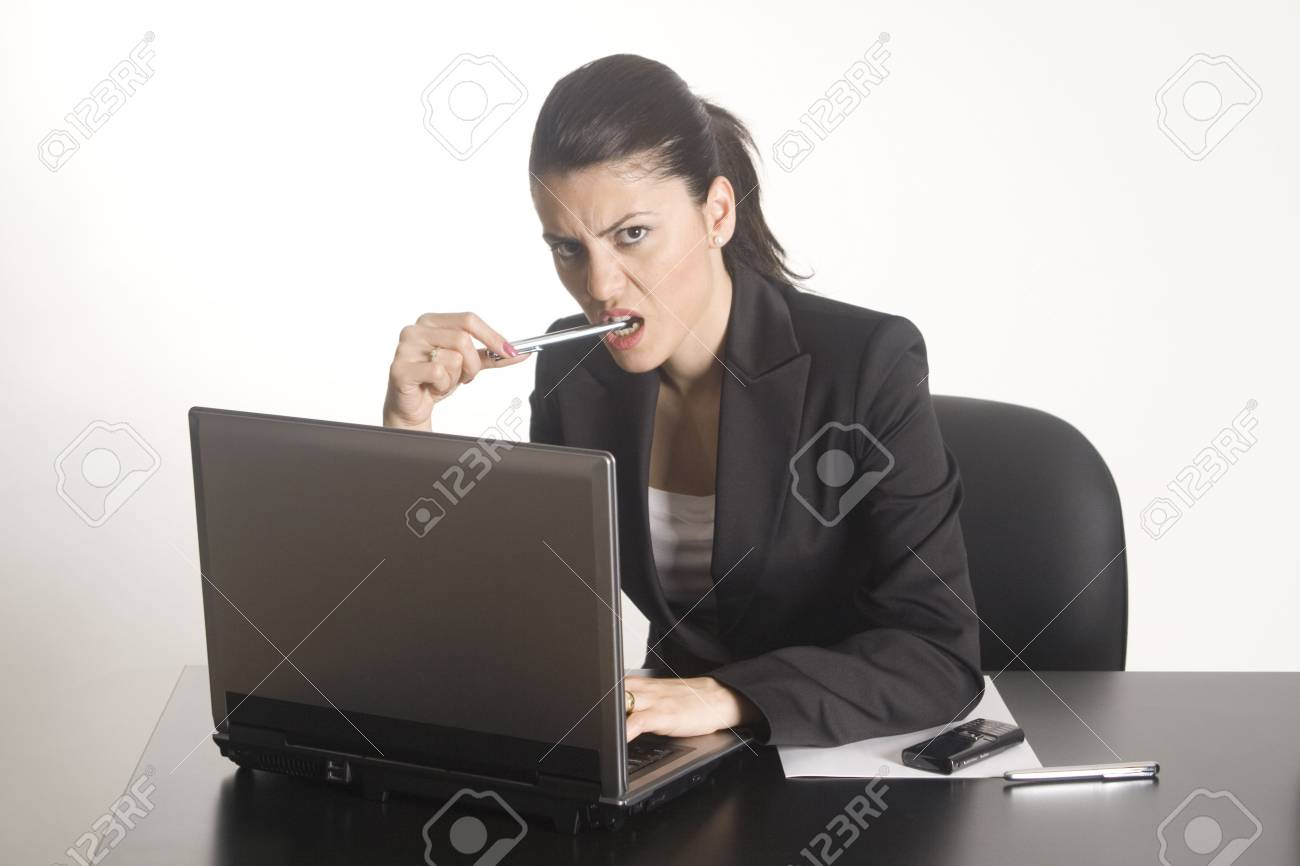 Businesswoman working on a computer at her office desk isolated against a white background. Stock Photo - 5266970
