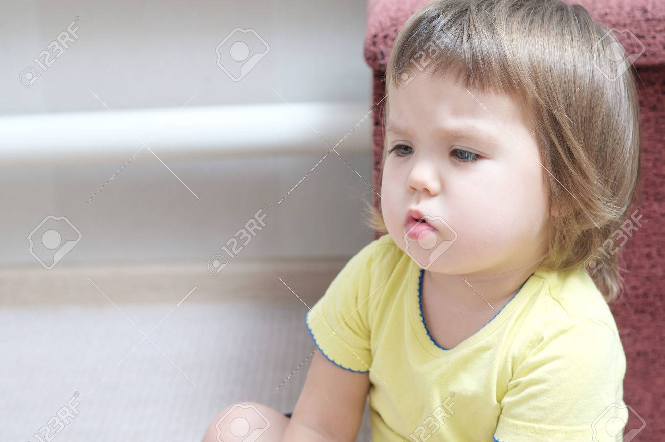 sulky baby girl talking and arguing, cute child portrait speaking