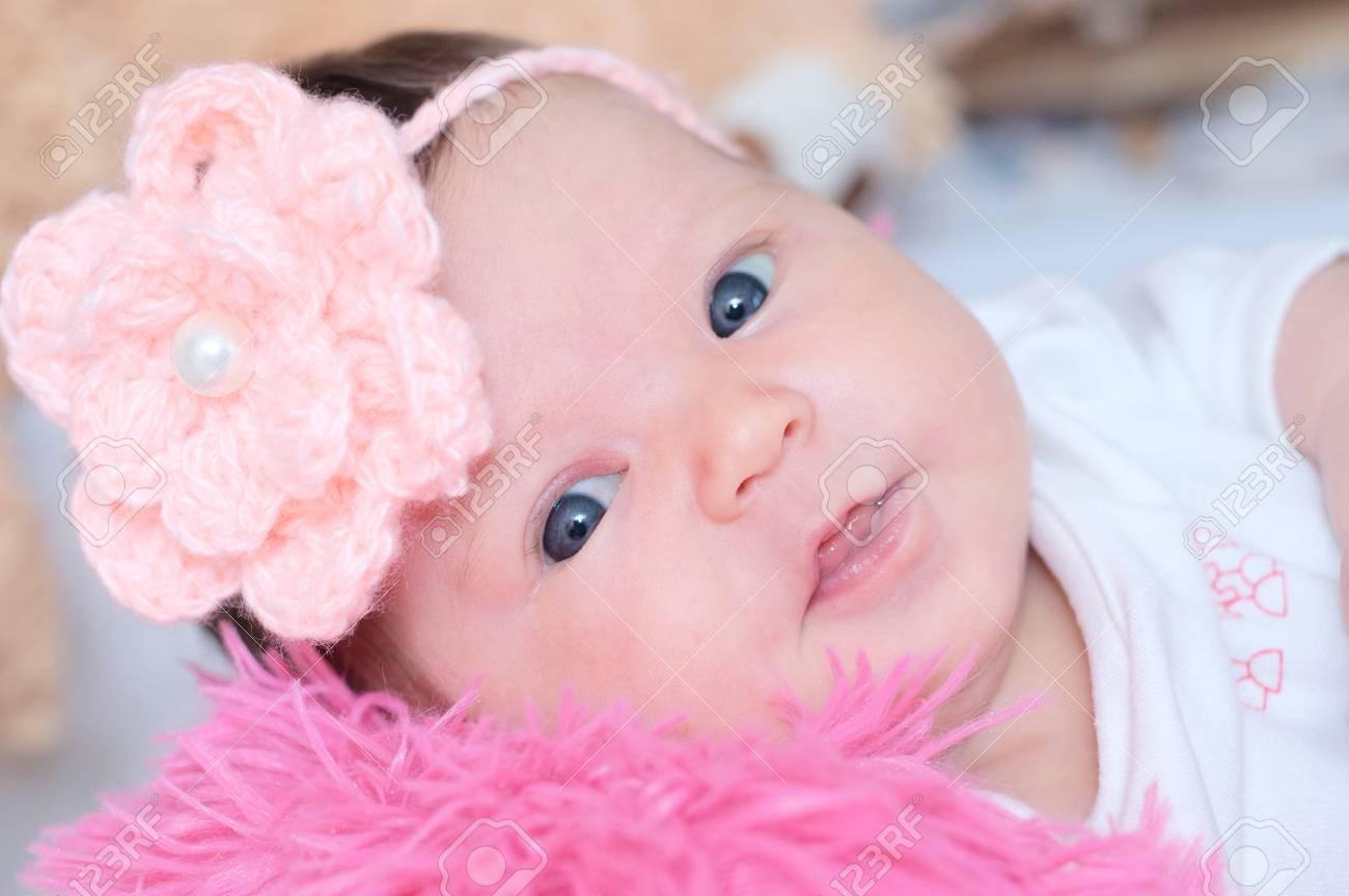 newborn baby girl portrait lying in pink blanket, cute child.. stock
