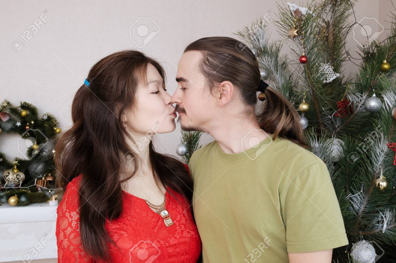 A Husband For Christmas.Pregnant Wife And Husband Kissing Each Other Happy Young Family