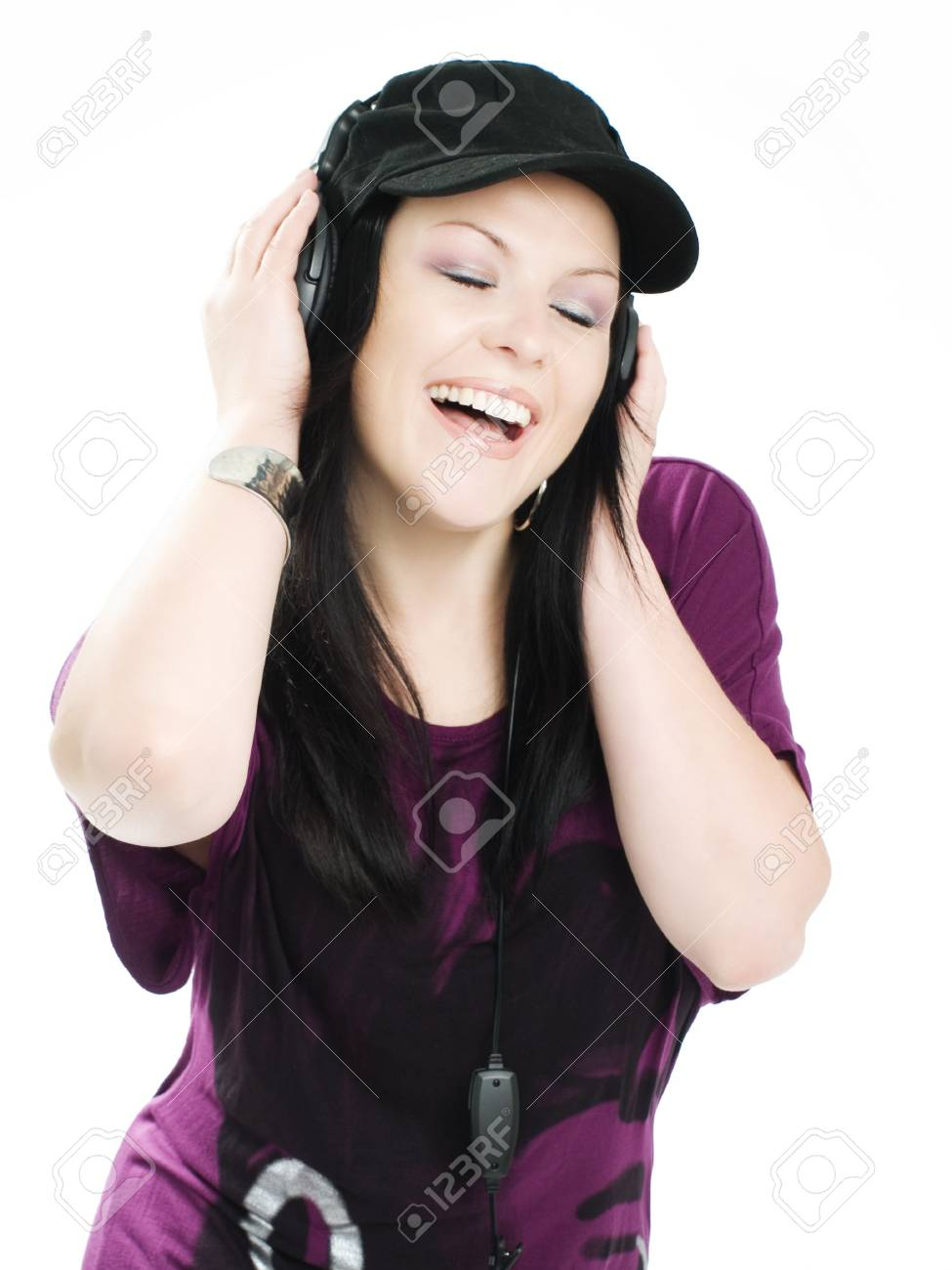 smiling woman with headphones and mp3 listening music Stock Photo - 5789669