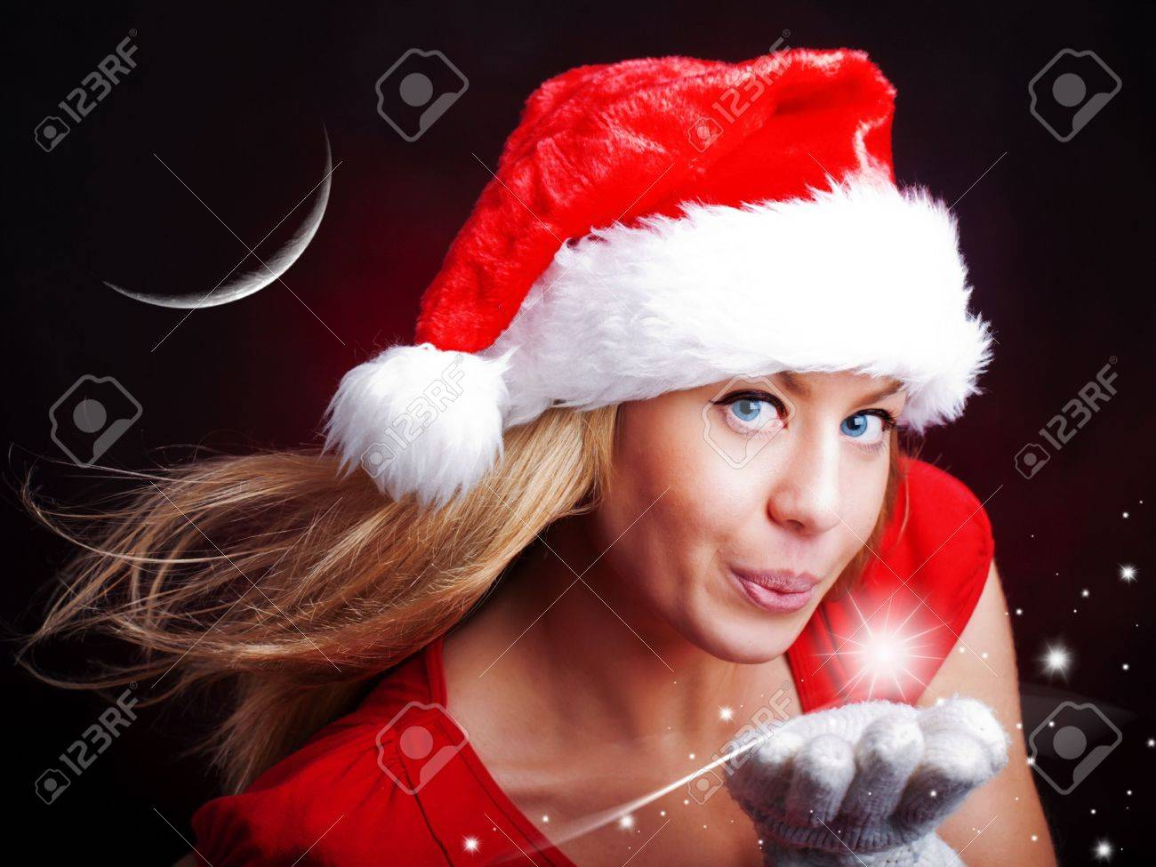 young christmas woman holding star over dark background Stock Photo - 7945357