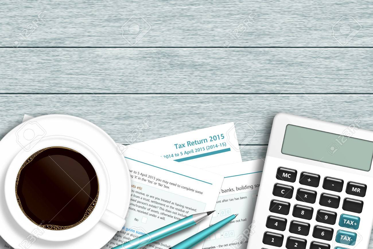 Uk tax form with calculator coffee lying on wooden desk with uk tax form with calculator coffee lying on wooden desk with place for text stock falaconquin