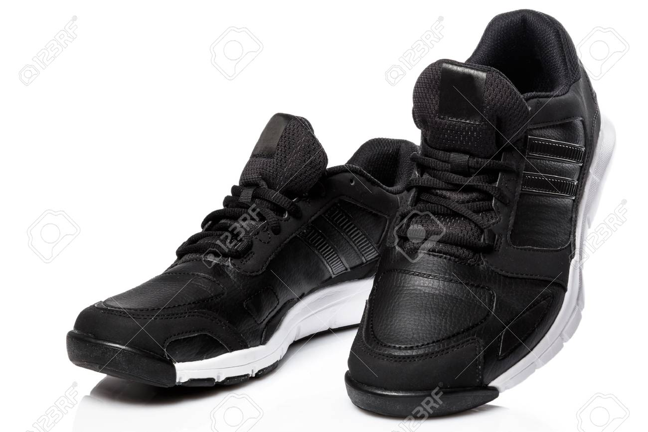 Black sport shoes on white background - 38013286