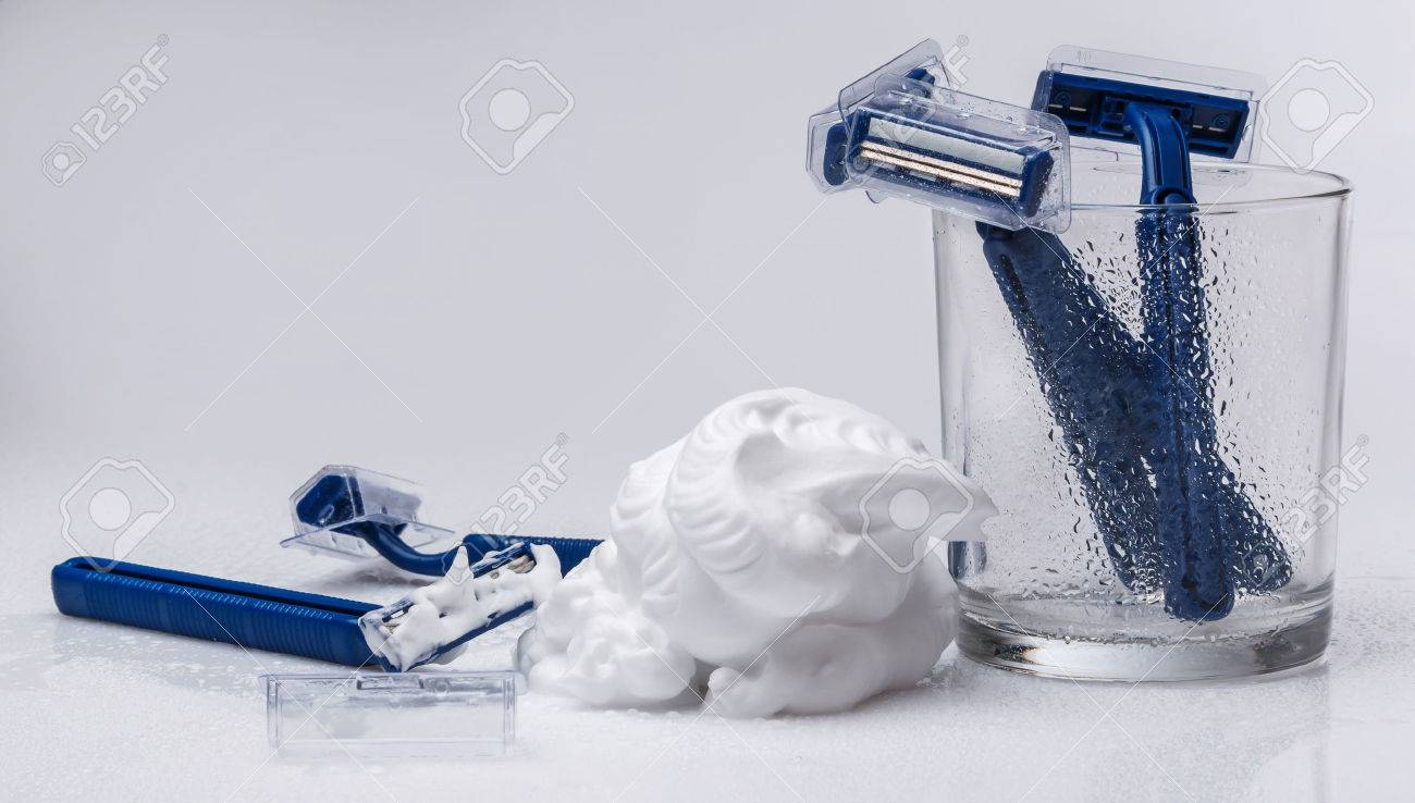 Shaving razors and foam on the table - 38016254