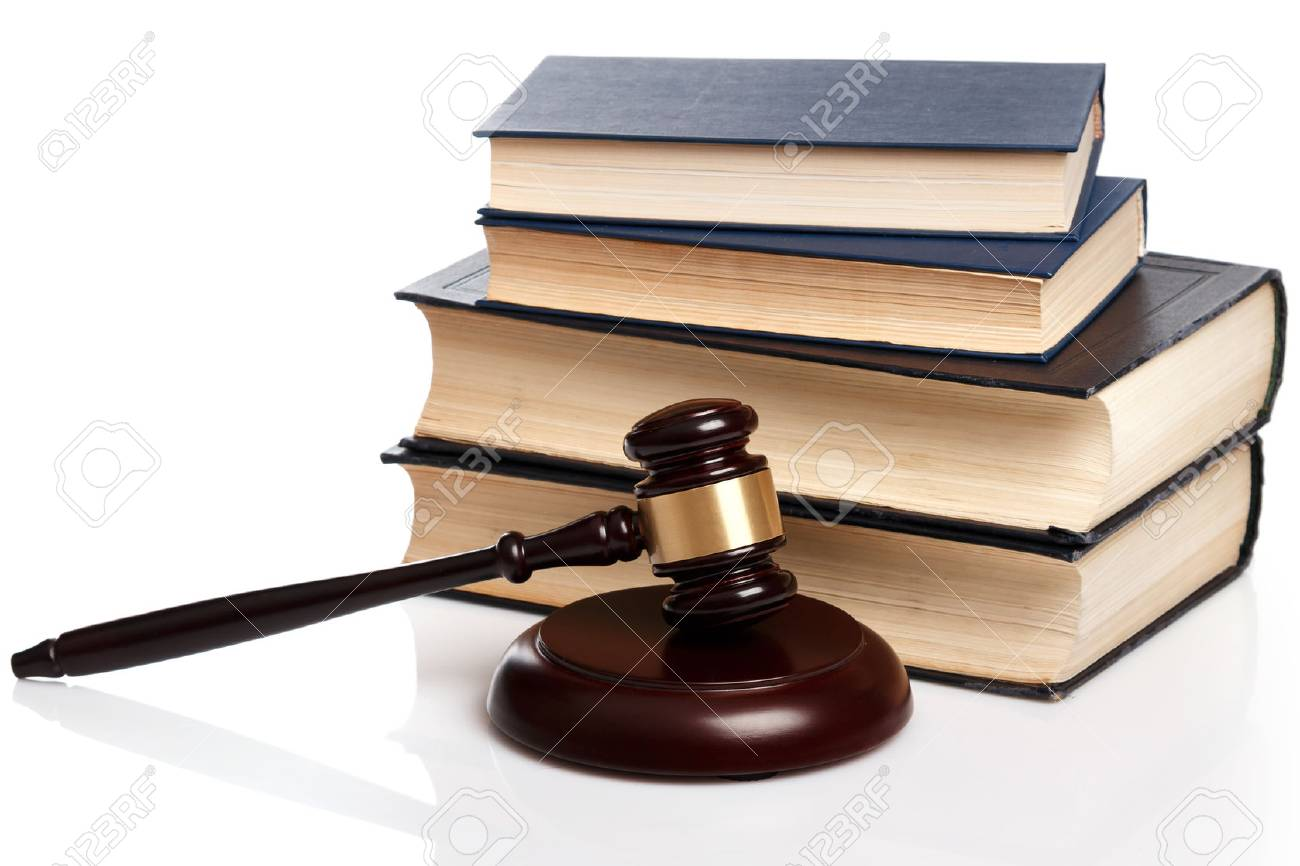 Gavel and books on white background - 40303979