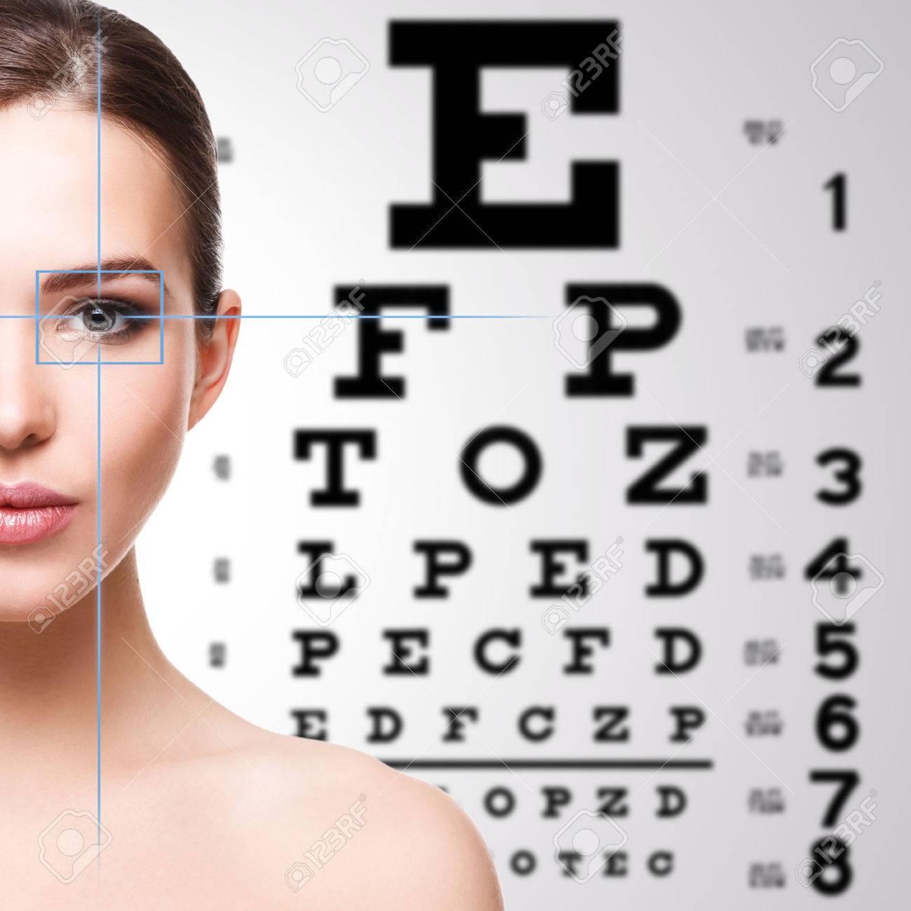 Beautiful woman and eye chart on background - 40463577