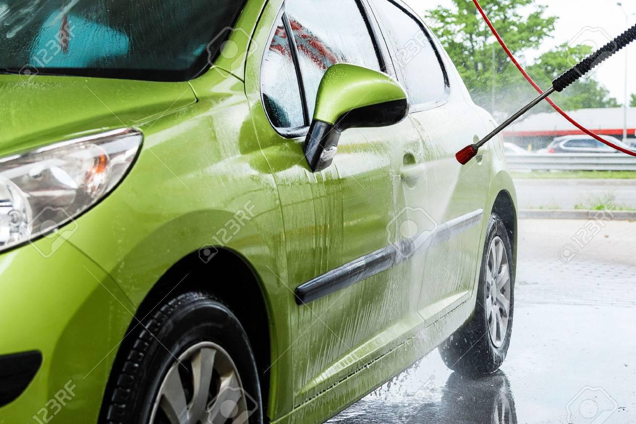 Green car in a hand car wash - 41847122