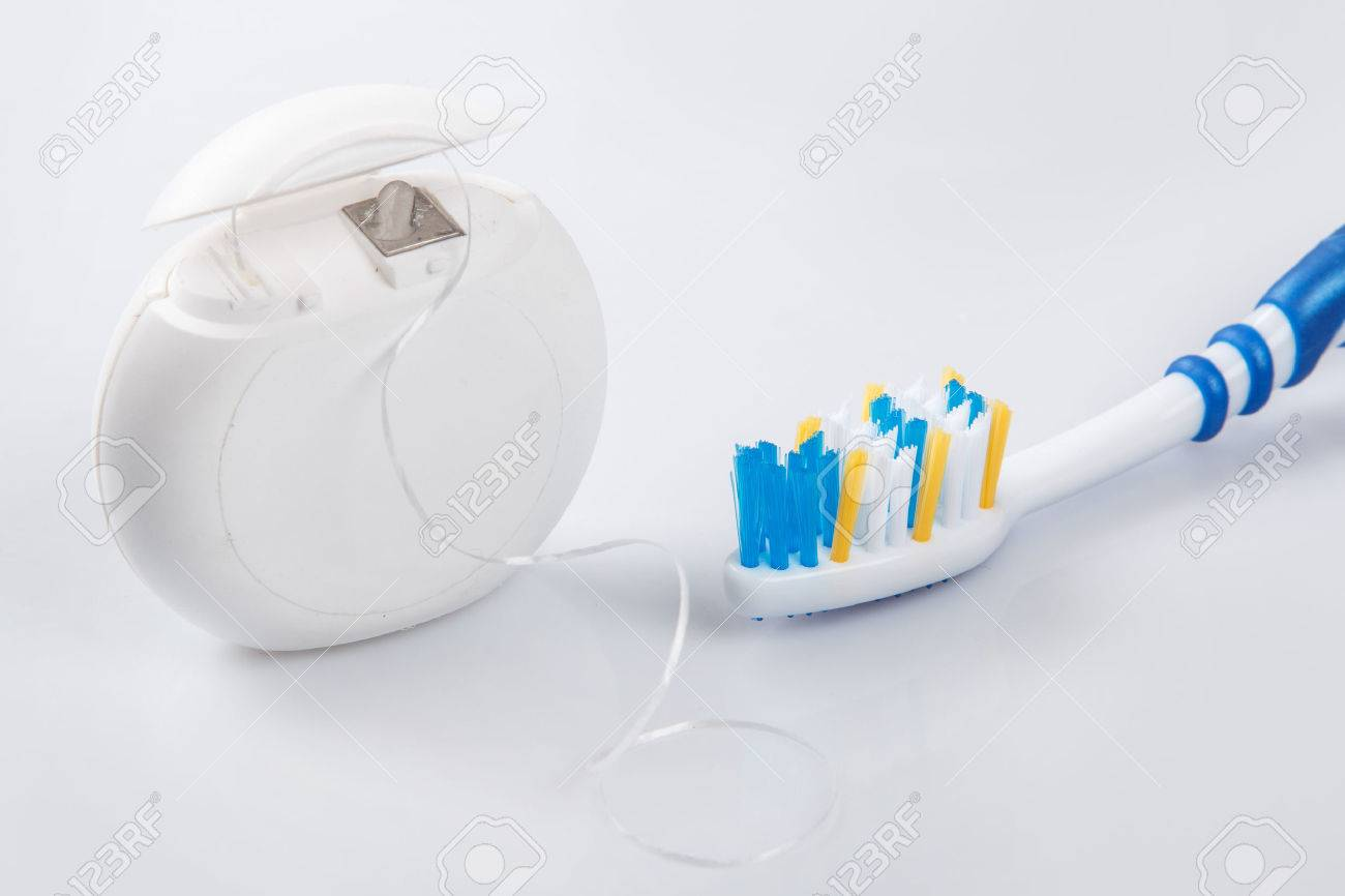 Close up of toothbrush and dental floss - 41846843