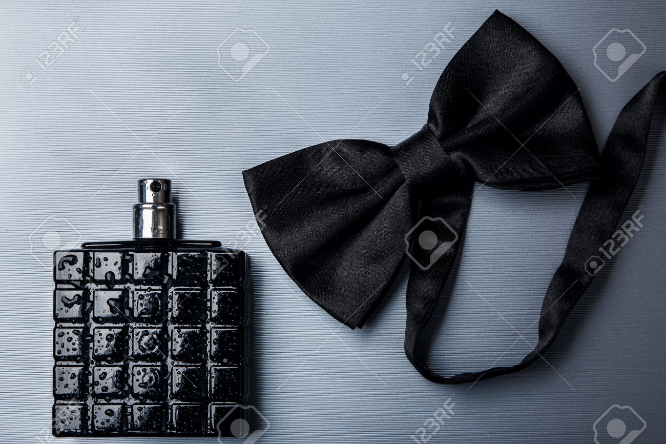 Bottle of male perfume and black bow tie - 41840020