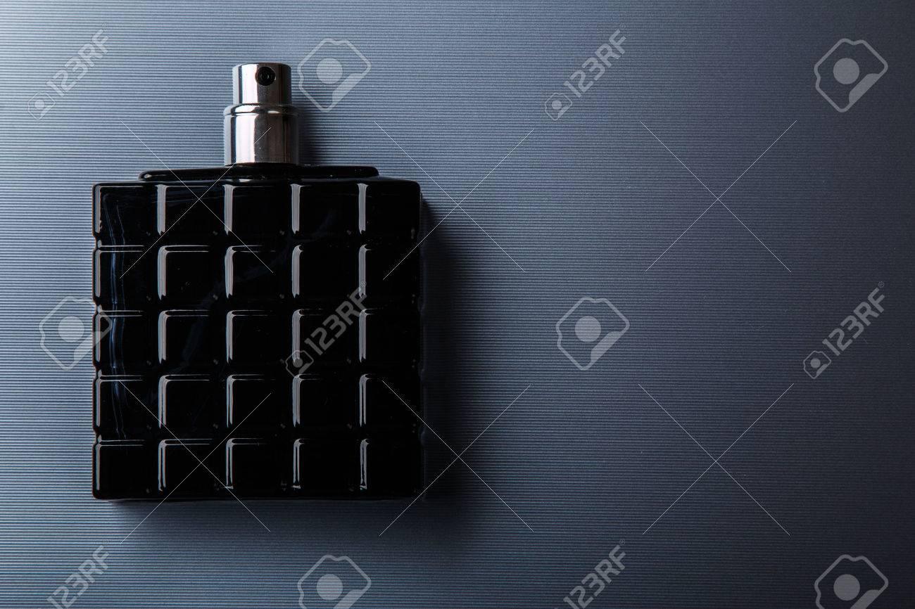 Black bottle of male perfume on metal surface - 41840041