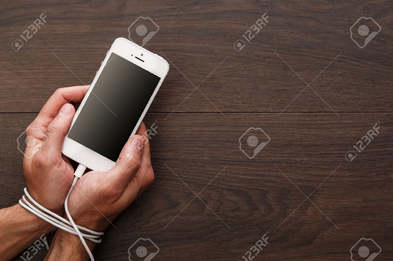 Male hands and smartphone. Addiction to internet and social networks - 46046379