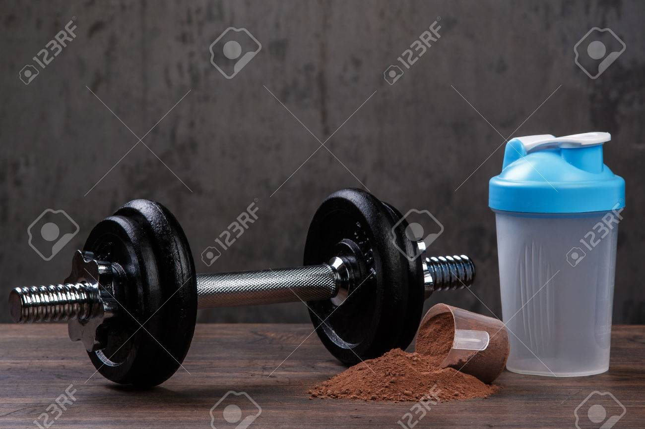 Heavy black dumbell and protein powder - 54966295