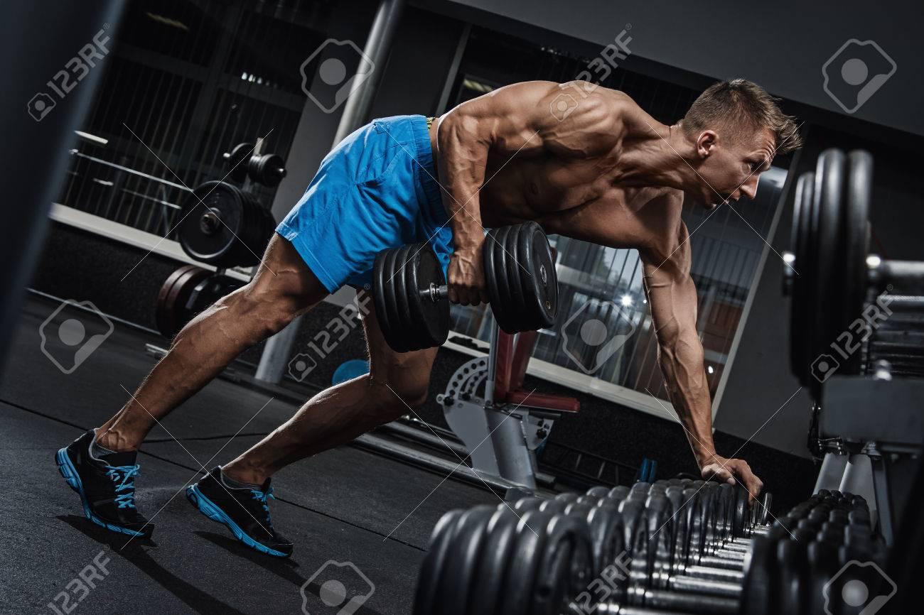 Man doing one-arm row exercise for his back - 56740990